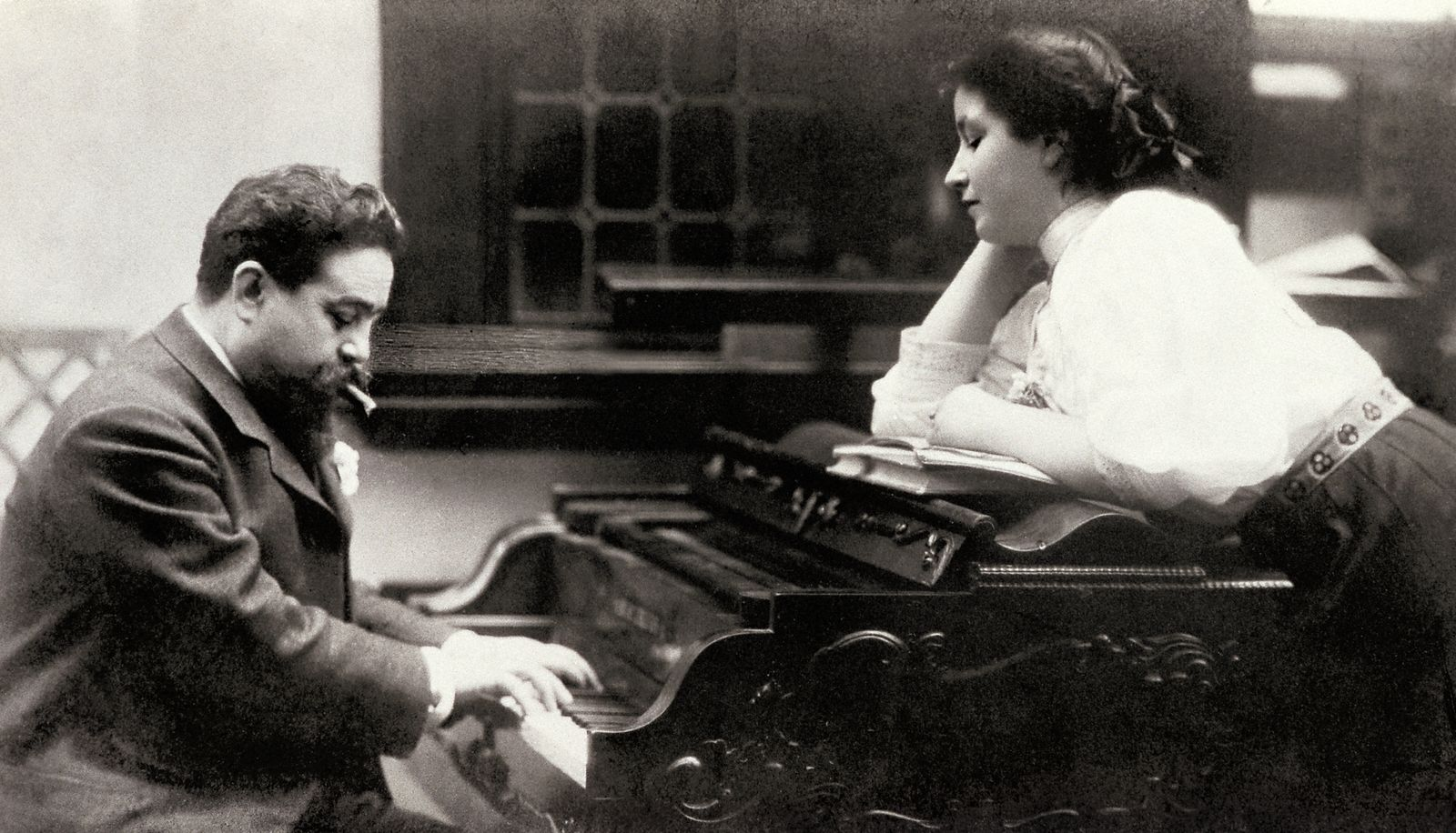 ALBENIZ, Isaac (1860-1909). Spanish pianist and composer. Portrait of Isaac Albeniz on the piano with his younger daughter Laura (1908). SPAIN. Madrid. Albeniz Foundation.
