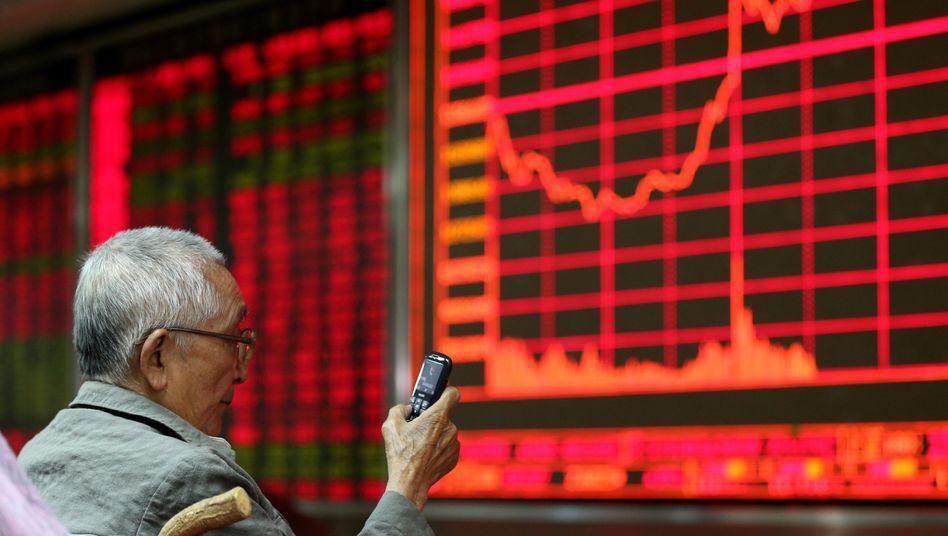 Handelsraum in Peking: Stärkster Eingriff seit 2008