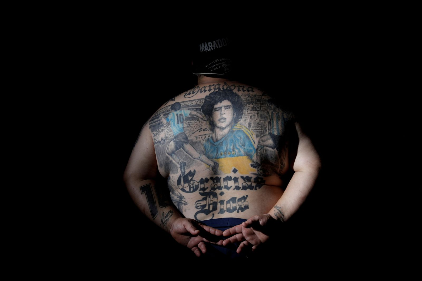 The Wider Image: Argentines celebrate 'eternal love' for Maradona with tattoos