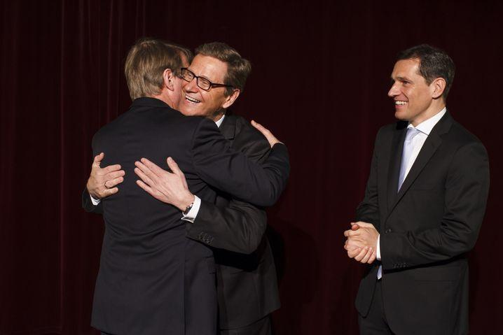 Mit Außenminister Westerwelle 2012 und dessen Partner Michael Mronz