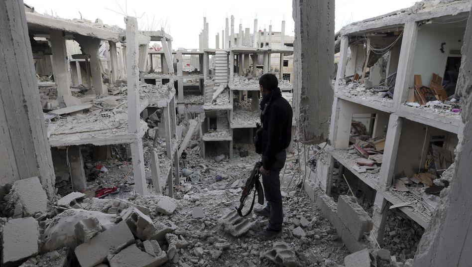 Kämpfer der Rebellen in Ruinen in Damaskus: Vertrauliche Liste mit Kriegsverbrechernamen