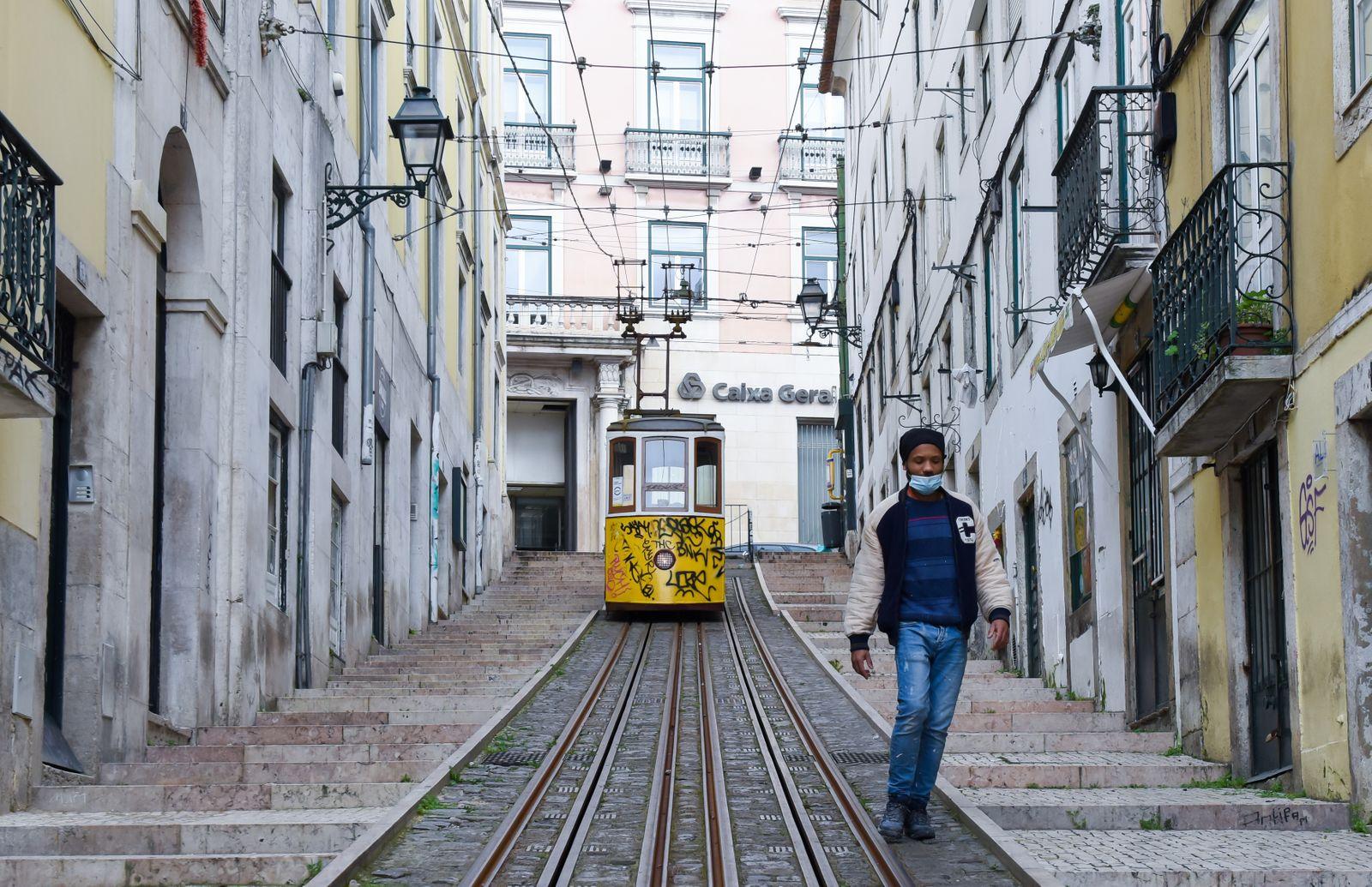 A man goes down Rua da Bica de Duarte Belo as Portuguese