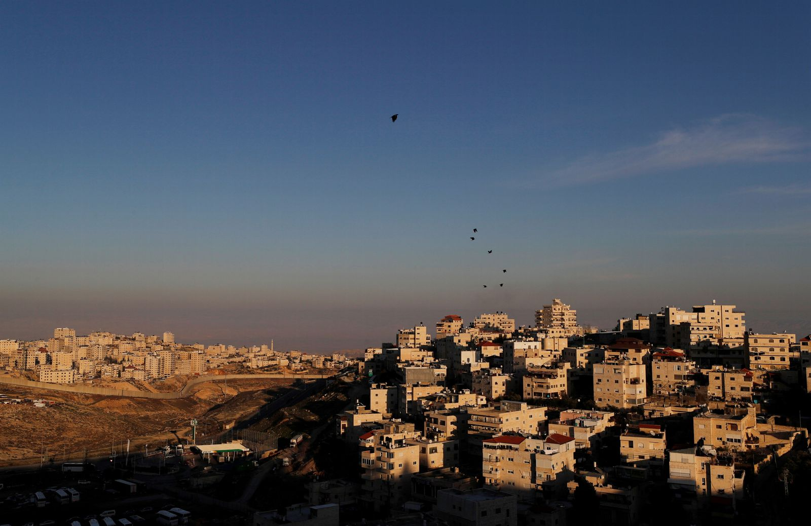 FILE PHOTO: A general view picture shows the Issawiya neighbourhood and the Israeli barrier running along the Shuafat refugee camp in East Jerusalem, in an area Israel annexed to Jerusalem after capturing it in the 1967 Middle East war
