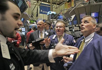Diskutierende Aktienhändler an der Wall Street: Wie groß ist der Spielraum der Rating-Agenturen?