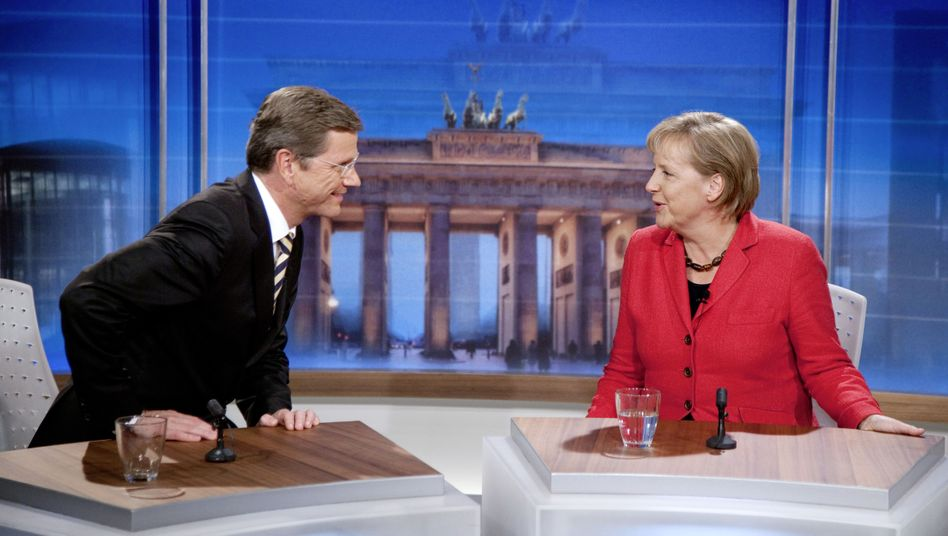 New partners: FDP leader Guido Westerwelle, likely to be Germany's next foreign minister, and Chancellor Angela Merkel in a post-election discussion on German TV on Sunday.