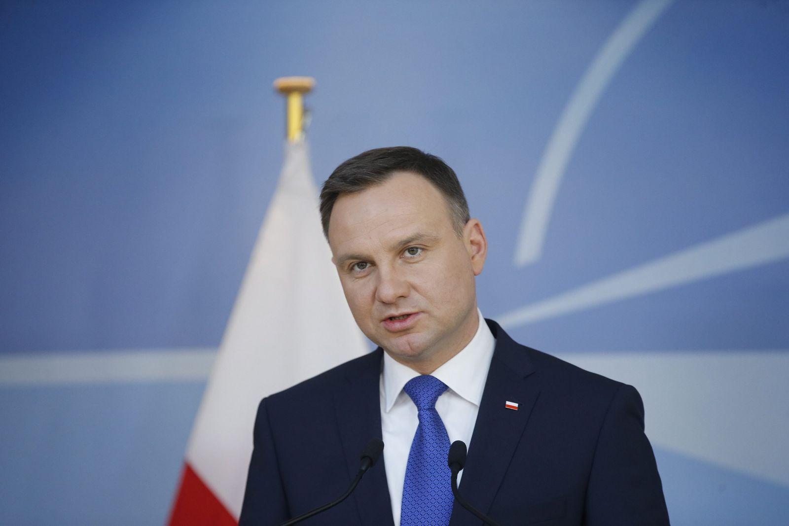 Polish President Andrzej Duda is welcomed by NATO Secretary Gener