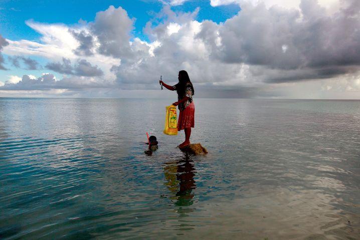Frau in Kiribati: Das Wetter endlich ernstnehmen