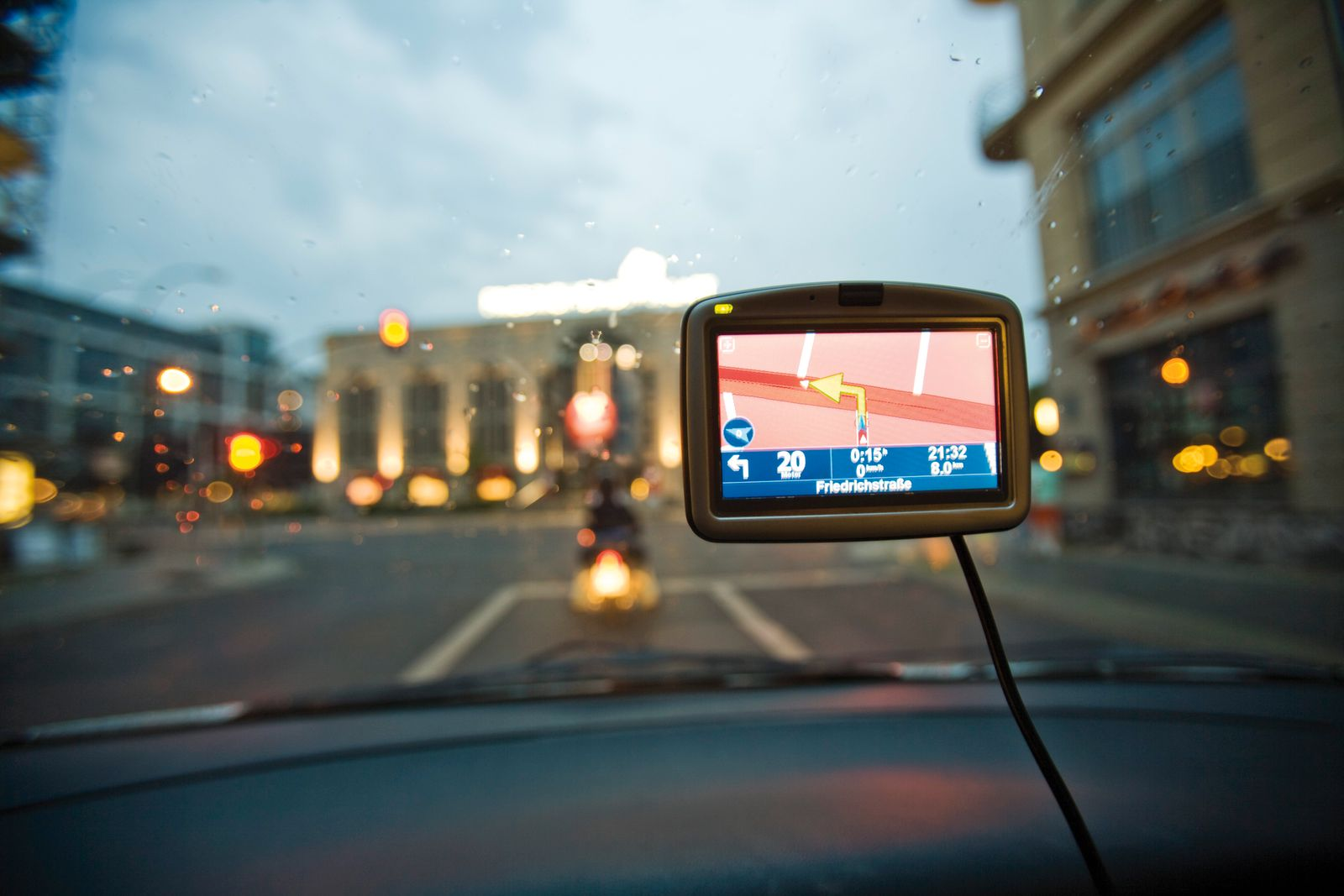 Germany, Berlin, Navigation system in car, Traffic seen through windscreen