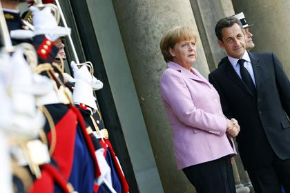 French President Nicolas Sarkozy and German Chancellor Angela Merkel agreed to differ at Saturday's mini-summit on the financial crisis in Paris.