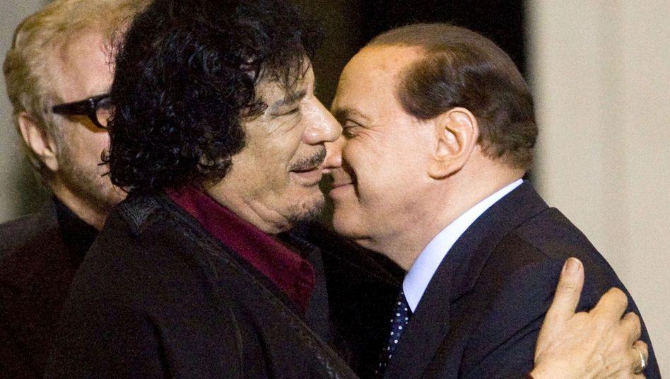 "Moammar Gadhafi and Silvio Berlusconi: The Libyan leader taught the Italian prime minister all about ""bunga bunga."""