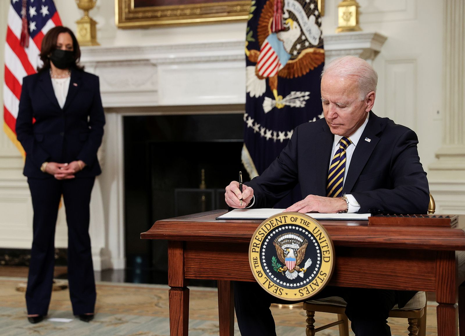 U.S. President Biden signs an executive order on the economy at the White House in Washington