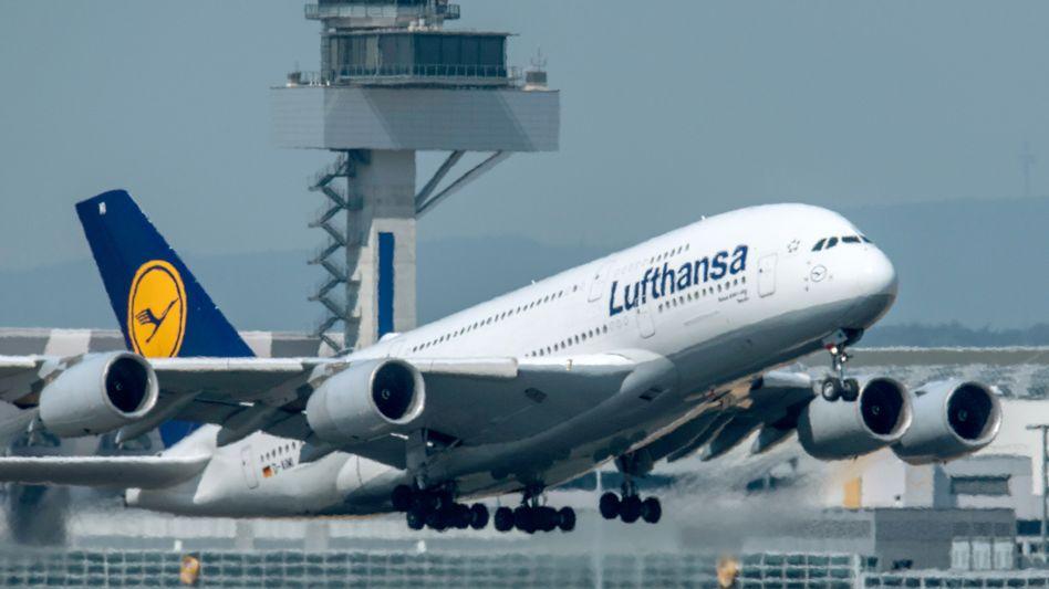 A Lufthansa A-380 aircraft takes off at the Frankfurt Airport.