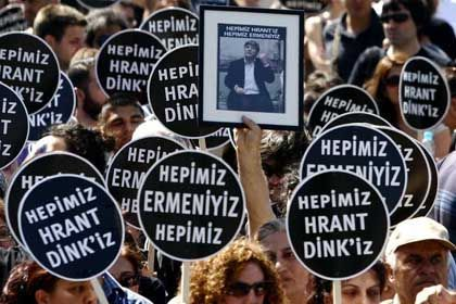 People demonstrate near the court in Istanbul where the Dink murder trial is being held.