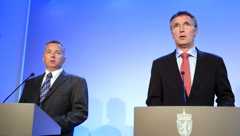 Norway's Prime Minister Jens Stoltenberg (right) and Minister of Justice Knut Storberget speak to the press about Thursday's terror arrests.