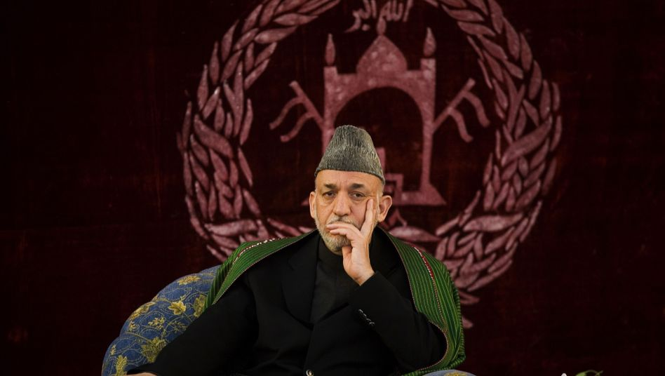 Afghan President Hamid Karzai. The CIA is alleged to kept on of his aides on the payroll.
