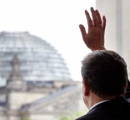 German Chancellor Gerhard Schröder takes a last look at the Reichstag from his office in the chancellery.