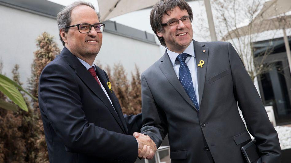 Carles Puigdemont (r.) und Quim Torra