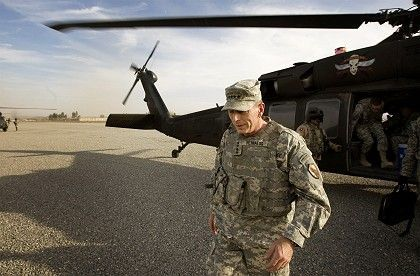 General David Petraeus walks away from a helicopter in Afghanistan. He now heads the US Central Command, which oversees US forces in both Iraq and Afghanistan.
