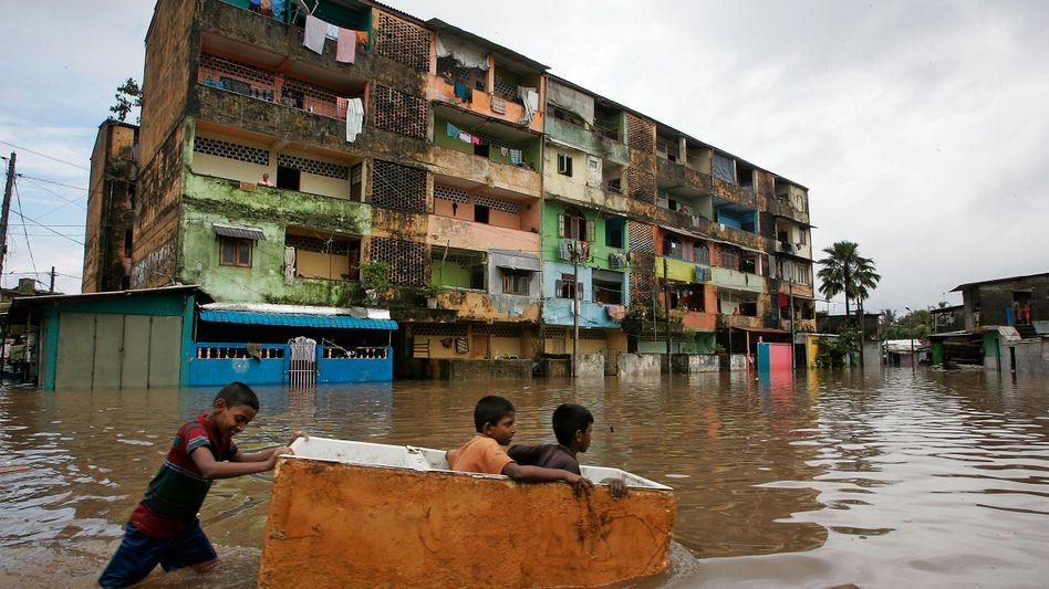 """Überflutungsopfer in Sri Lanka (November 2010): """"Vorsorge zahlt sich aus."""""""