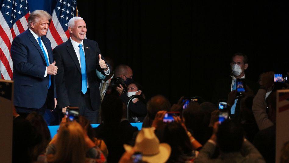 Donald Trump (l.) und sein Vize Mike Pence: Knapp drei Millionen weniger vor den Fernsehern