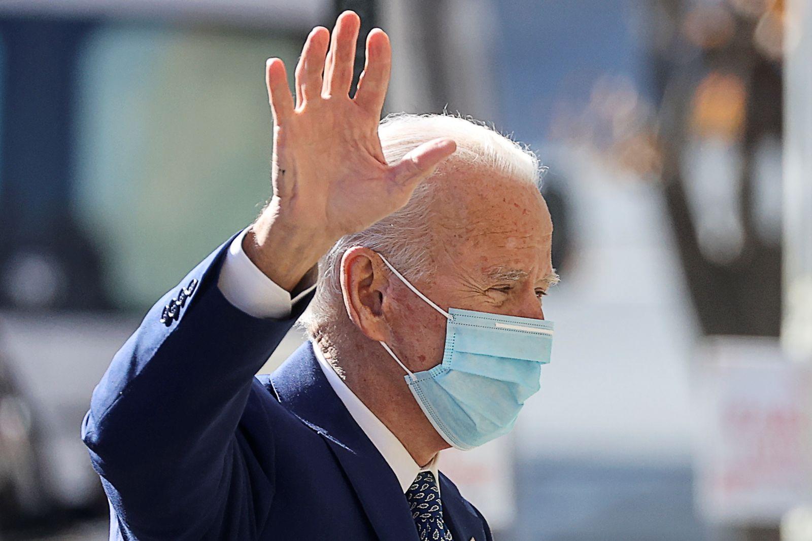 U.S. President-elect Biden waves to reporters prior to attending coronavirus briefing in Wilmington, Delaware