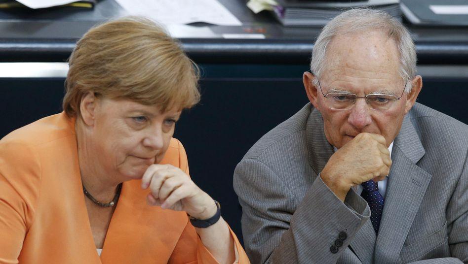 Kanzlerin Merkel, Finanzminister Schäuble: Die Kälte ist zurück
