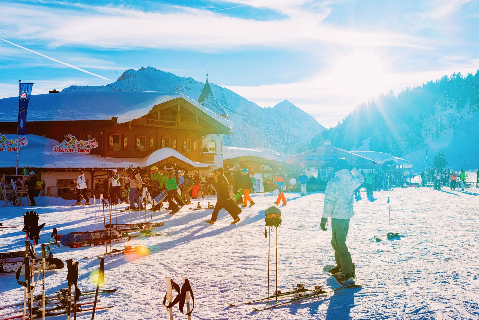 People at restaurant chalet Penken Park Austria sun flare