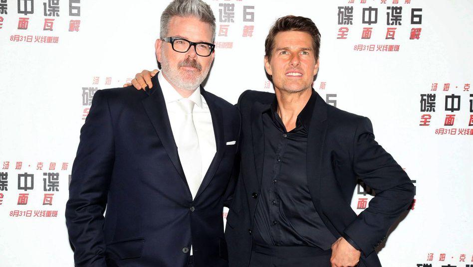Regisseur Christopher McQuarrie (l.) mit und Tom Cruise
