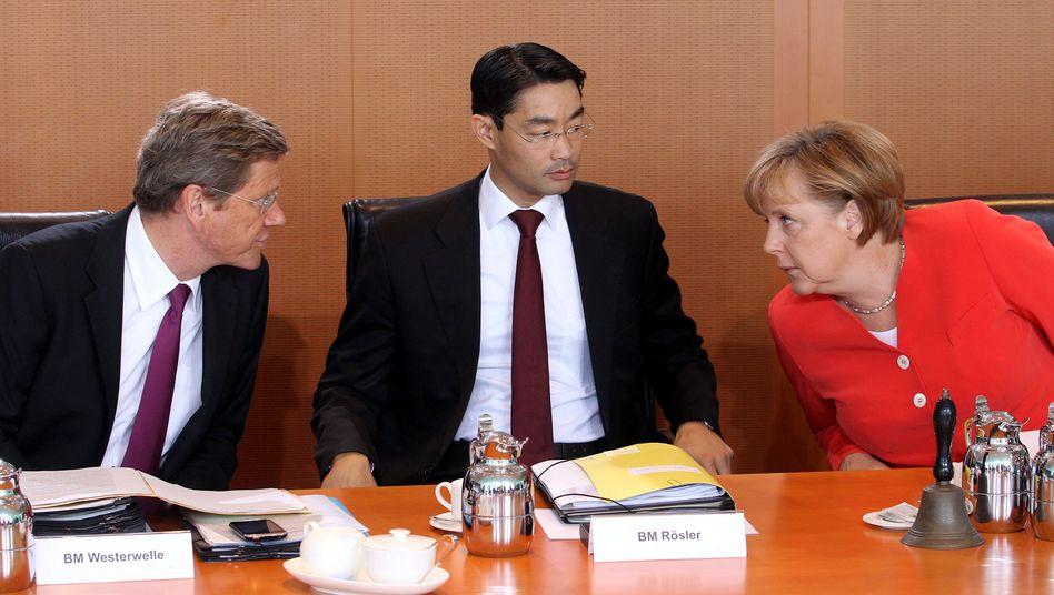 Westerwelle, Rösler, Merkel: Einigung auf Haushaltsentwurf