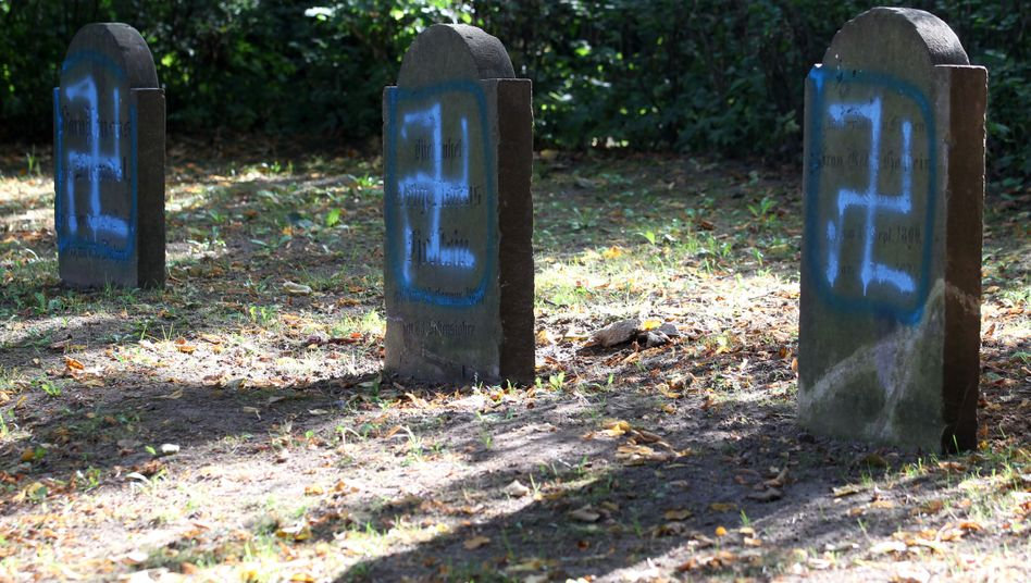 Gravestones desecrated with swastikas in a Jewish cemetery in northeastern Germany.
