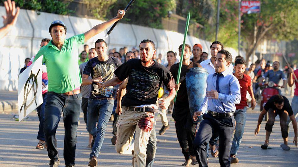 Zusammenstöße in Kairo: Mursi-Anhänger werden verfolgt