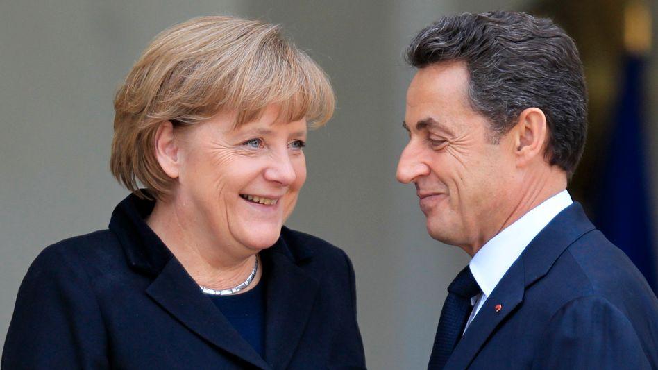 Politiker Sarkozy, Merkel: Drängen auf einen neuen EU-Vertrag