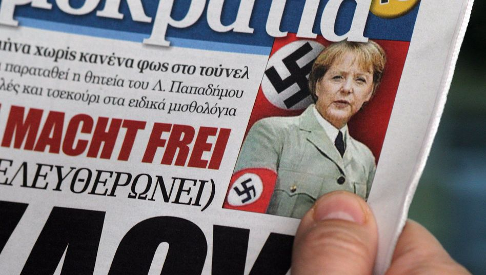 "The front page of the Greek right-wing daily ""Democracy"" on Feb. 9: ""Memorandum Macht Frei"""