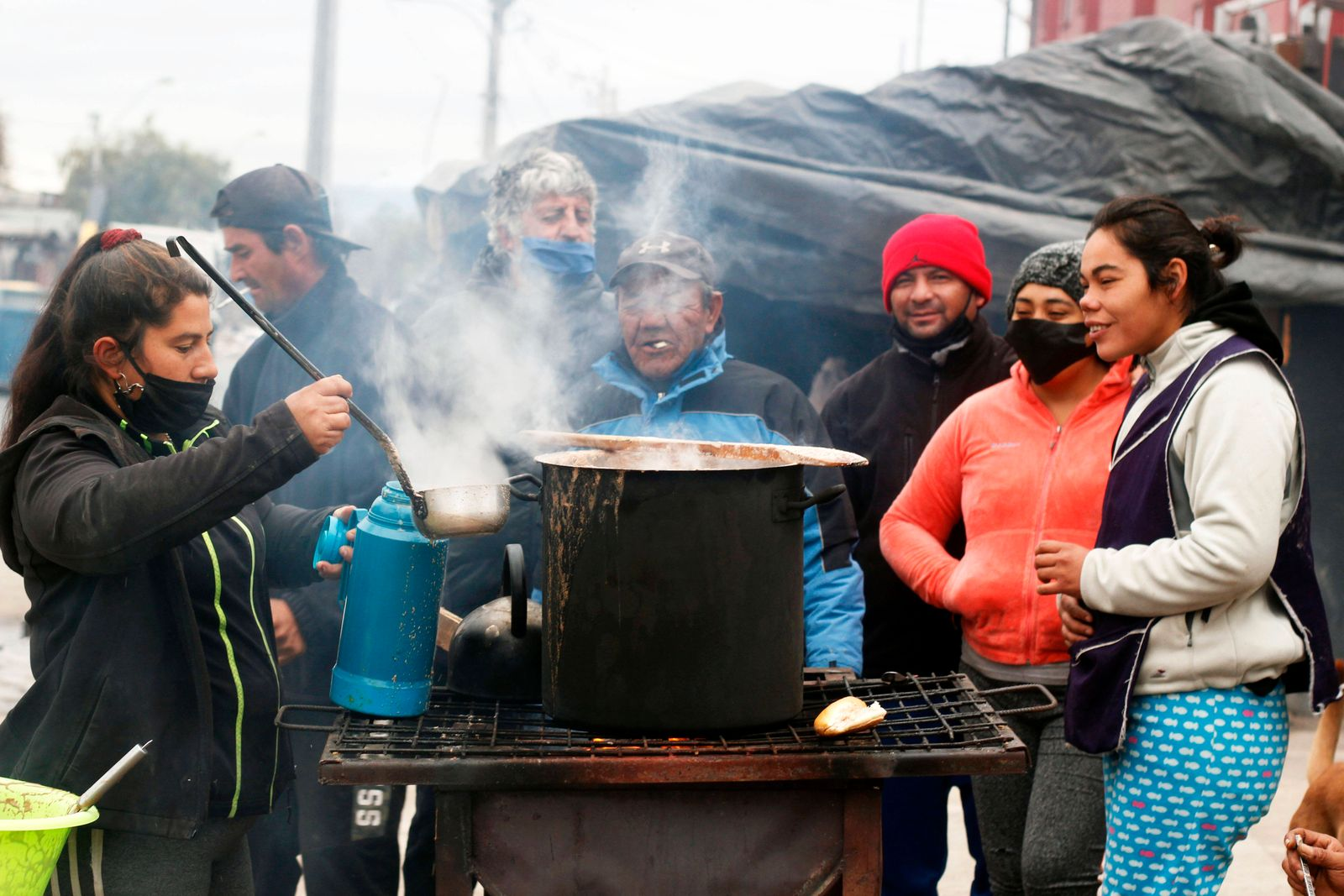 June 3, 2020 - Santiago, Chile - A group of neighbors cooks during a common pot (self-managed soup kitchen) in the midst