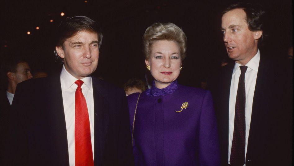 US-Präsident Trump (Archivbild) mit seiner Schwester Maryanne Trump Barry und beider kürzlich verstorbenem Bruder Robert, der ihn bis zu seinem Tod Mitte August öffentlich unterstützt hatte
