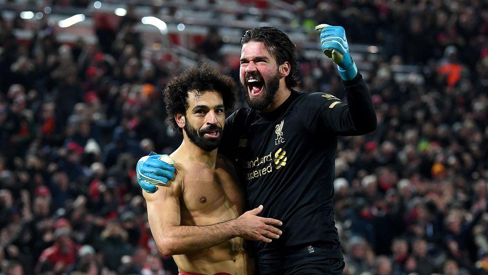 Mohamed Salah (l.) und Alisson Becker (r.) sprinteten unwiderstehlich über den Platz - ein Sinnbild für den FC Liverpool