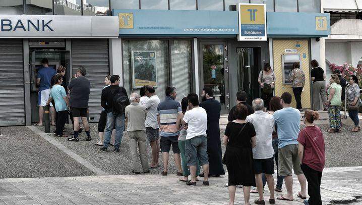 Schlangen vor Bankautomaten: Die Griechen fürchten um ihr Geld