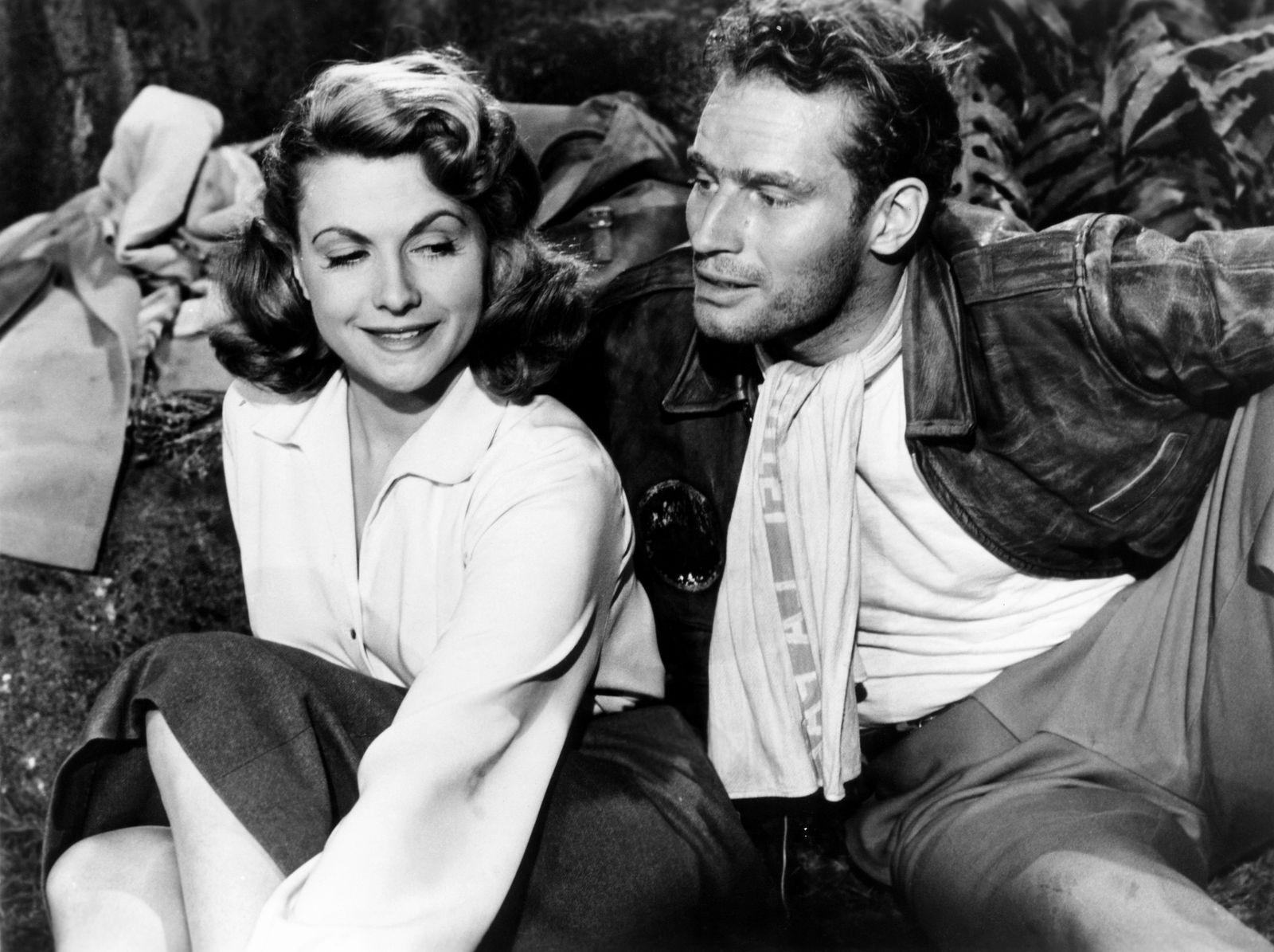 SECRET OF THE INCAS, from left, Nicole Maurey, Charlton Heston, 1954