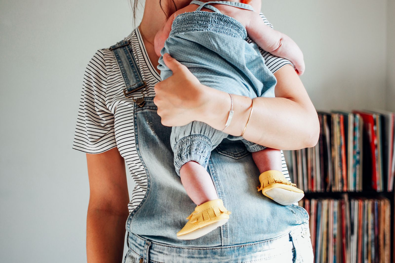 Mother Holding Baby On Her Shoulder