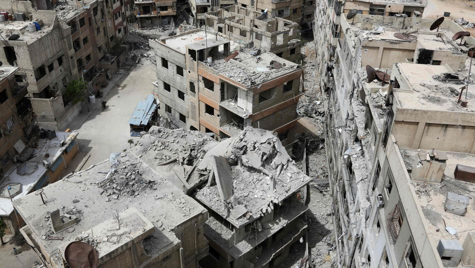 Destroyed buildings in a suburb of Damascus, Syria (archive photo)