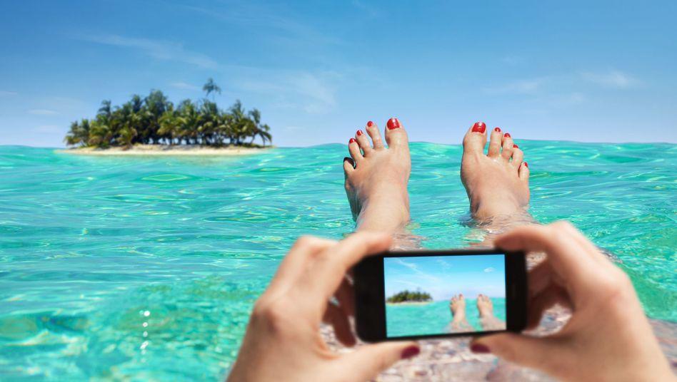 Handyfoto aus dem Urlaub: Knipsen und zahlen