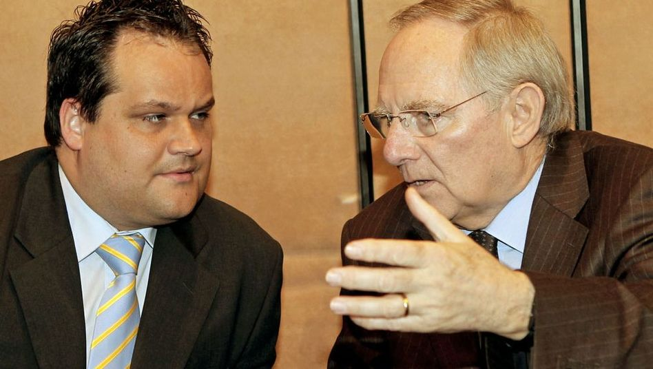 Dutch Finance Minister Jan Kees De Jager (L), talking to his German counterpart Wolfgang Schäuble.