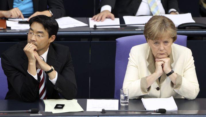 Merkel and Economics Minister Philipp Rösler, a member of her junior coaltion partner, the Free Democratic Party (FDP): a loveless alliance.