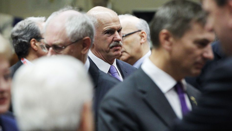 Greek Prime Minister Giorgios Papandreou arrives for a European Union summit in Brussels.