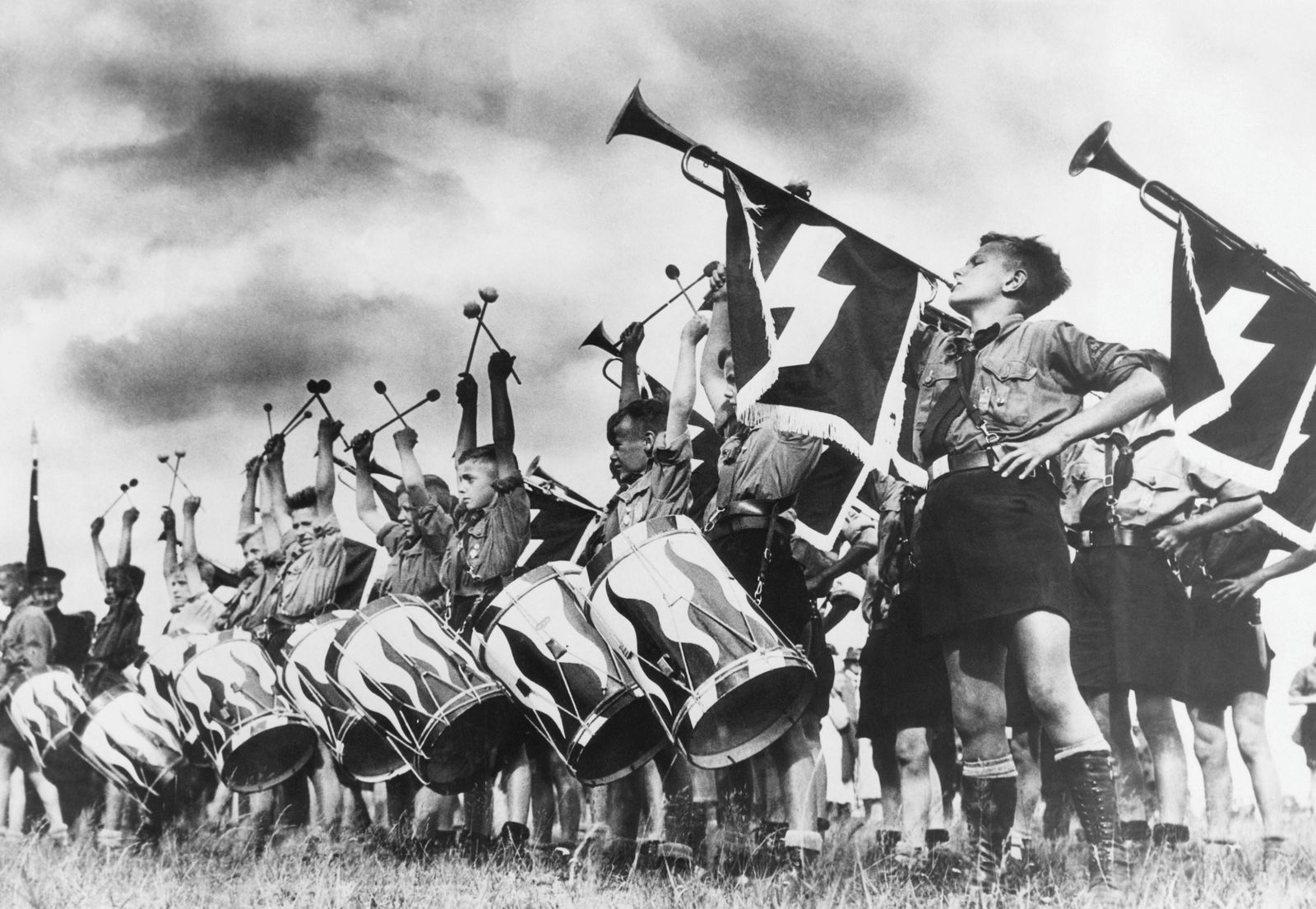 Nazi Germany. Hitler Youth play drums and sound trumpets in Brandenburg, at the Camp of Germany, where 1,500 boys and gi