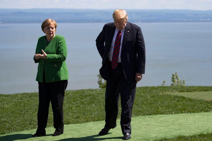 Trump mit Bundeskanzlerin Angela Merkel in Kanada