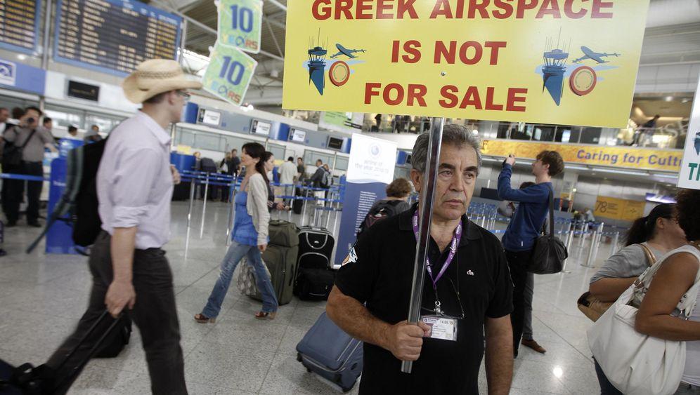 Proteste in Athen: Beamte fürchten den Absturz