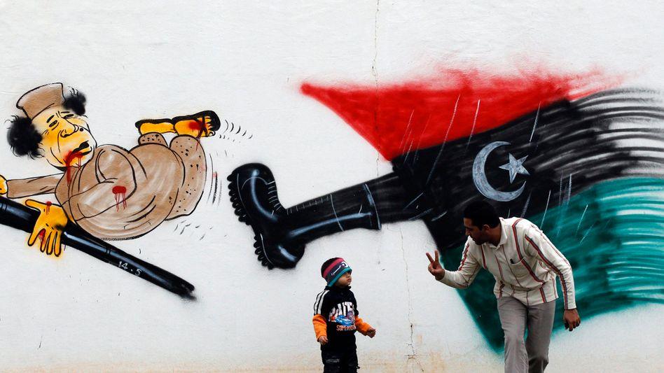 Protest-Graffiti gegen Gaddafi: Aufruhr in einem gespaltenen Land