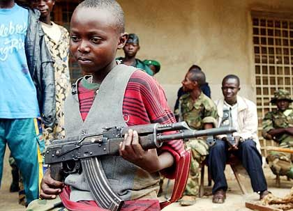 Thousands of child soldiers, like this 12-year-old in Bunia, are involved in the fighting in Congo.