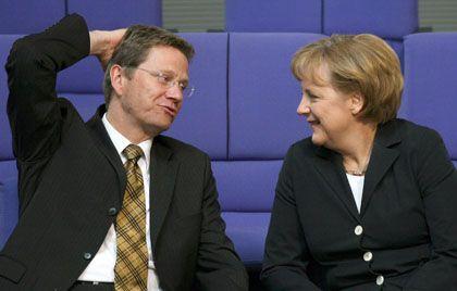 Westerwelle, Merkel: FDP und Union lehnen Wahlrechtsreform ab